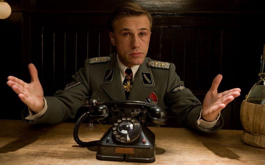"""#3 - Uno spietato leader nazista che va orgogliosissimo del proprio soprannome, """"Il cacciatore di ebrei"""". Stiamo parlando di Hans Landa (..."""